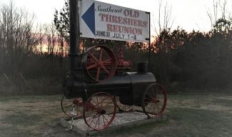 Denton Farmpark sign and old steam engine